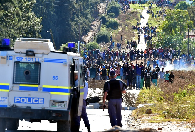 Police were out in full force to establish order as protesters blocked the entrance to the Moses Mabhida township in Kirkwood.
