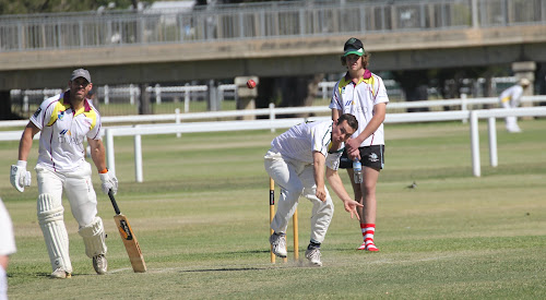 Man-of-the-match Michael Cain bowls on Saturday. Cain took 4-16 in nine overs which included two maidens. Watching on are Civeo batsman Lachlan Cameron and umpire Jordyn Mowle.