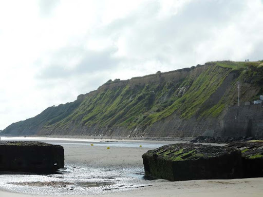 Normandy-hillsides.jpg - The enclosing hillsides added to the air of solemnity.