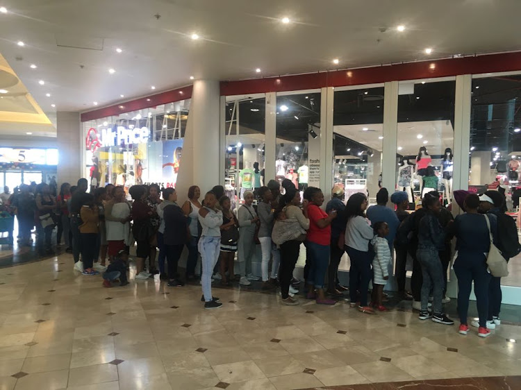 Shoppers hungry for a sweet deal at Canal Walk shopping mall in Cape Town on 24 November 2017.
