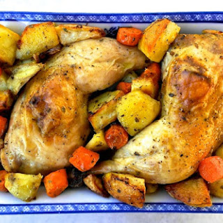 Greek Style Roasted Lemon and Garlic Chicken with Potatoes and Carrots.