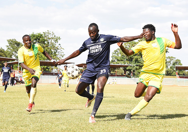 Allan Wanga (R) and Moses Mudavadi (L) tries to stop Vihiga United's Victor Ademba in a past match
