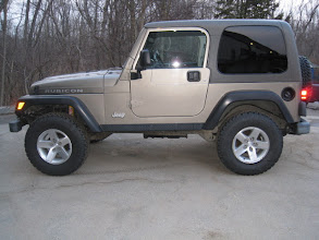 "Photo: OME 2"" kit with stock Rubi rims"