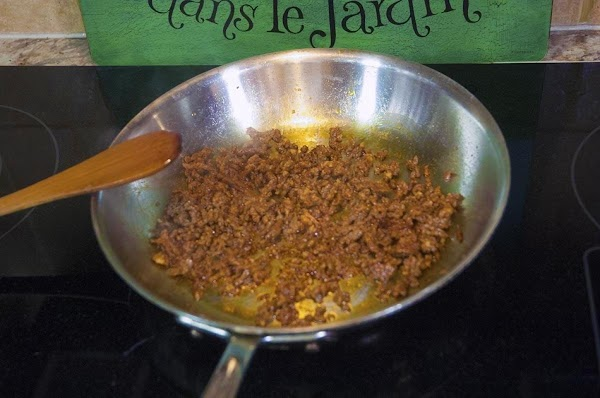 Stir, breaking up the meat with a wooden spoon, until fully cooked, about 6...