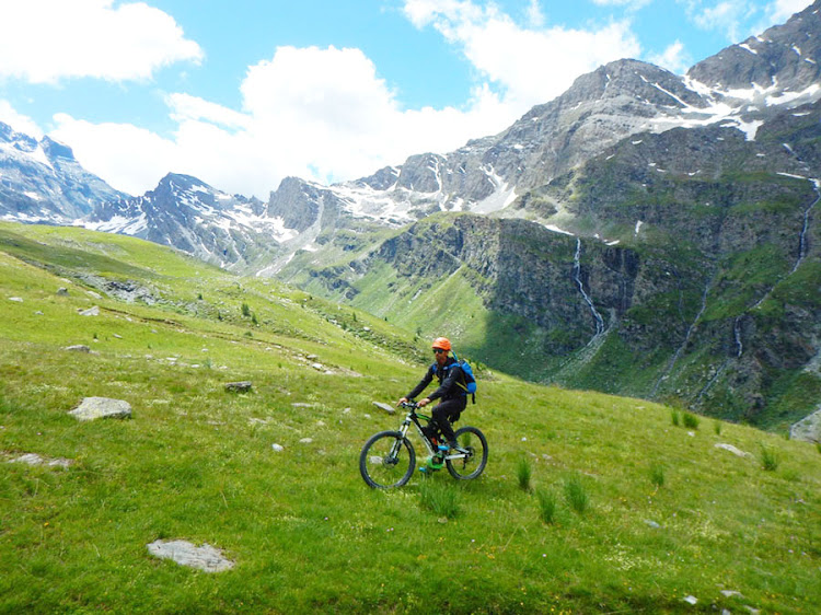 Francois Lombard tackles a verdant Alpine hillside on an electric bike.