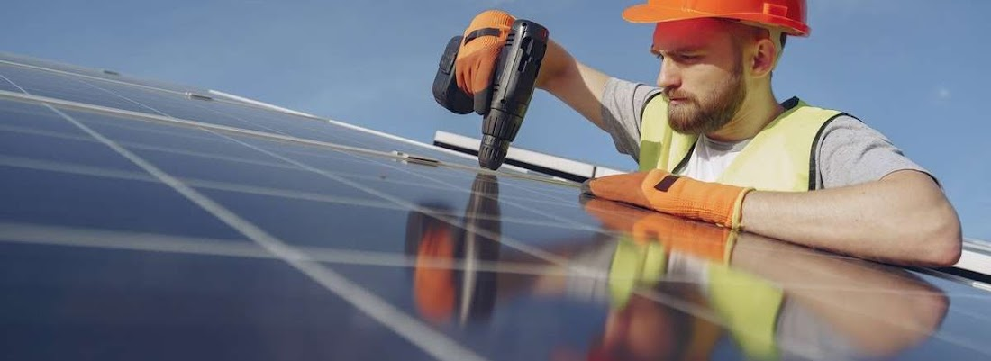electrician fixing a solar panel