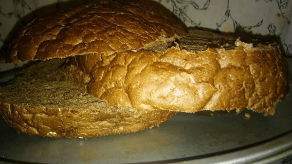 Either make or buy a large round loaf of dark rye bread.  Cut in in...