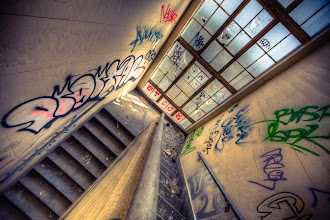 Photo: Down We Go  Maybe it's the general chaos that you can find on an UrbEx shoot but I think all of it lends to how I see while I roam these hallways. +Amy Heidenwas off in another corridor doing her thing while I held a crazy session of +Really Right StuffTripod Yoga. I distinctly remember the position of this one and it would certainly be fit for its own spot on +Trey Ratcliff's Camerasutra T-shirt (http://store.stuckincustoms.com/gear/camera-sutra).  Iintentionallyhad my Canon 14mm f/2.8L II lens on to bring anexaggeratedamount of distortion here. Because I had the camera pivoted downward, I felt that the enlargement of the skewed vertical and horizontal lines really led to helping the viewer's eye roam through the frame. See. Distortion really can be our friends. :)  In terms of processing This is a seven exposure tone-mapped HDR image. I stylized using split-toning in Lightroom 4.3. All final touches were also applied in Lightroom.  #blog