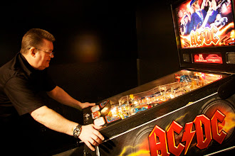 Photo: Steve Ritchie playing his own pinball. I played with him!