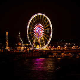 Giant Wheel by Avtar Singh - Public Holidays Christmas ( lights, reflection in water, night views, giant wheal )