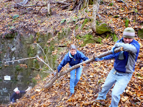 Photo: Stephanie below pushing & me & Brian pulling a larger branch up