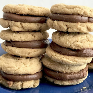 Peanut Butter Sandwich Cookies With A Chocolate Filling.