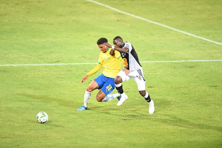 Rushine De Reuck of Mamelodi Sundowns and Jean Othos during the Caf Champions League match against TP Mazembe at Loftus Versfeld Stadium on March 16 2021 in Pretoria.