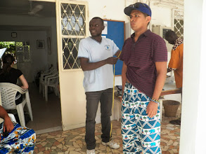Photo: Being measured by the tailor for our new clothes!