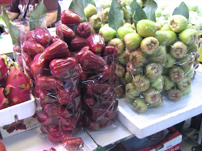 """Photo: two varieties of """"chompoo"""" (rose apples) next to dragon fruit on the far left"""
