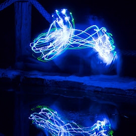 Step Outside by Savannah Eubanks - Abstract Light Painting ( pond, reflection, blue, double image, night, light painting, fairy lights, water, lights )