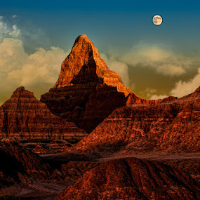 Moon over the Badlands by Eugene Linzy - Landscapes Mountains & Hills ( clouds, hills, mountains, moon, trail, badlands, dusk )