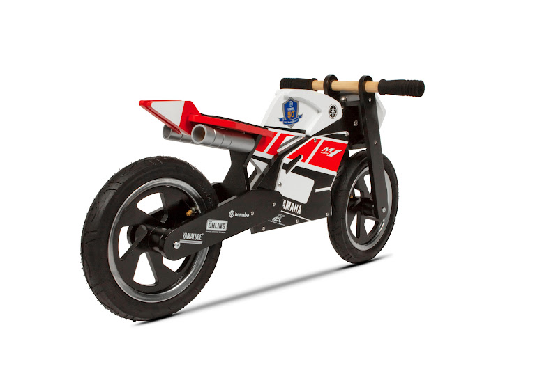 Photo: Yamaha Kids Bike WGP 50th Anniversary * Features slick tyres, fairings, underseat exhaust pipes, sculpted rear swingarm and styled tank and tail * Comfortable riding position for kids from 2 to 6 years old * Kids learn how to balance and steer in a safe, quick, fun way and look cool at the same time * Helps to develop the kids' balance and coordination when riding the two-wheeled * Child safe paint  Specifications: - Material: Natural birch plywood sourced from managed forests - Dimensions: Height handlebar: 440mm. Seat height 330-350mm. Wheelbase 615mm - Certified conformity: (CE/TÜV/WVTA): CE-approved. Safety tested on EN71 - Suitable for: 2-6 year olds  For further detailed information and availability, please consult your local Yamaha dealer.Only available in Europe