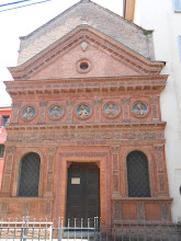 Photo: Pretty facade in Bologna, which we saw as were were walking off the huge sandwiches we had just eaten for lunch.