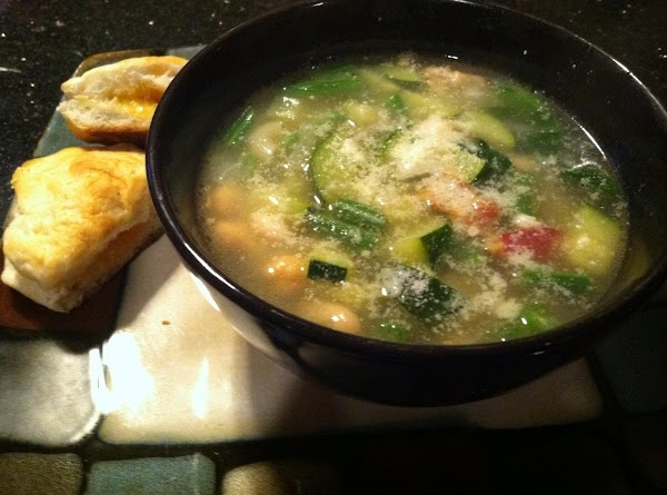 LADLE INTO BOWLS  N TOP WITH GRATD CHEESE...ENJOY :)