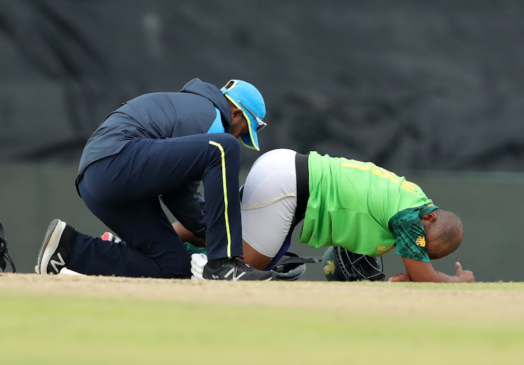 Proteas captain Temba Bavuma receives medical attention during the third and final ODI match against Pakistan at SuperSport Park on April 7 2021. Bavuma went down after what looked like a hamstring problem.