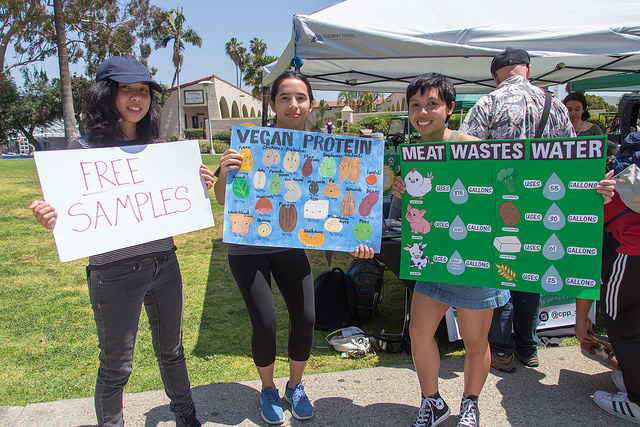 Members of the Students for a Sustainable Future holding signs at University Park.