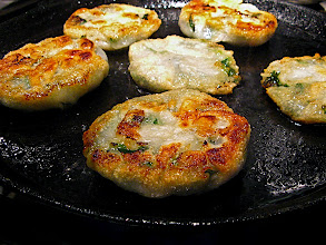 Photo: stuffed chive cakes browning in pan