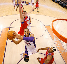 Photo: Phoenix Suns Grant Hill jumps to the basket past Philadelphia 76ers player Spencer Hawes at US Airways Center in Phoenix, Ariz. Photo by Rob Schumacher, The Arizona Republic.
