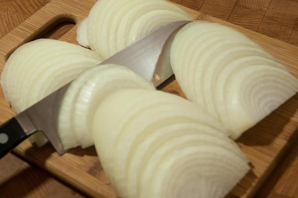 While the butter is melting, cut the onions, pole-to-pole, remove the skin and thinly...