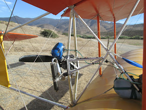 Photo: Having the engine in back instead of in front makes the flight quieter and less windy for the pilot, as well as keeping the oily exhaust off of things. While on the ground, people are kept safely away from the propeller by the tail structure and bracing cables. The single rudder of the Bloop 2 is in the propwash so it provides good steering control at low speeds while the plane is rolling on the runway. With the propeller located over the lower wing, noise is reflected upward, making things quieter on the ground, and the propeller is protected from gravel strikes and brush.