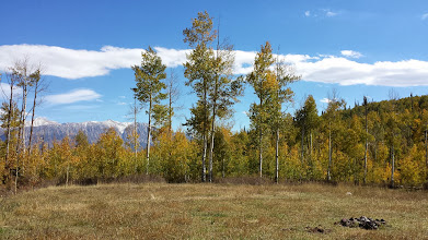 Photo: At the end of one access road, an old fire ring with the Ragged Mountains in the background - a potential well pad location.