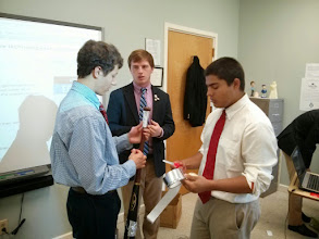 Photo: Students discussing prototypes.