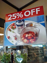Photo: The first thing we see when we get the food bit downstairs.... 25% off Pimms! Hurray for Wimbledon!