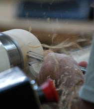 Photo: Mike demonstrated in his initial shaping of the bowl how he puts his fingers under the rest for support.  He supports the tool with his thumb on top of the tool.