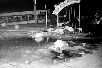 Photo: 28 Jun 1965, Ho Chi Minh City, Vietnam --- Original caption: Saigon: A Floating Nightmare. Shattered bodies lie sprawled about at the entrance area of a floating restaurant here June 25th, after two Viet Cong bombs claimed 42 lives and injured 80 persons. The majority of fatalities occurred when the second bomb went off at the gangplank entrance to the boat-restaurant, trapping many who were fleeing from the first blast. Among the dead were 27 Vietnamese, 12 Americans, one German, one Frenchman, and one Filipino. --- Image by © Bettmann/CORBIS