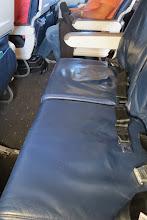 Photo: Onni on oma rivi lentokoneessa!