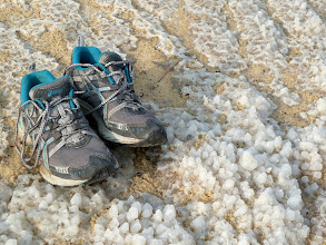 Photo: Here you can see the mix of sand and salt deposits. (The shoes are for a size reference.)