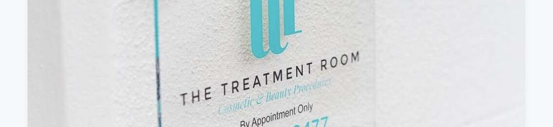 the treatment room logo printed on a wall