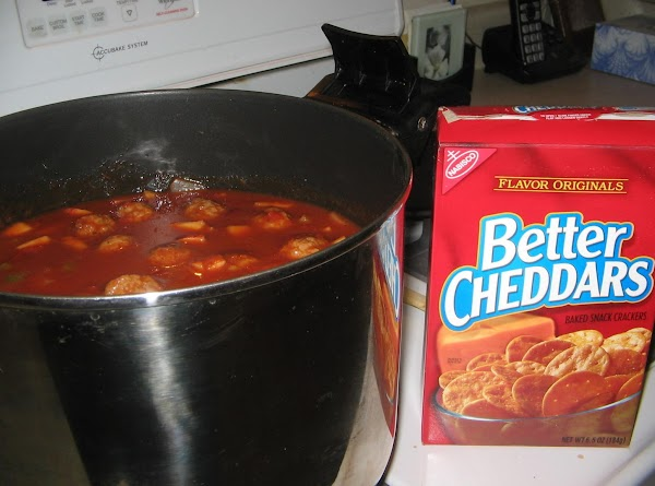 Stir in all remaining ingredients, and simmer until meatballs have thawed. Enjoy!Serve with cheddar...