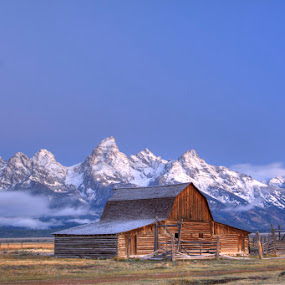 Mormon Row District, with John Moulton barn in front of the snow capped Teton Range. by Rick Lombardo - Landscapes Travel