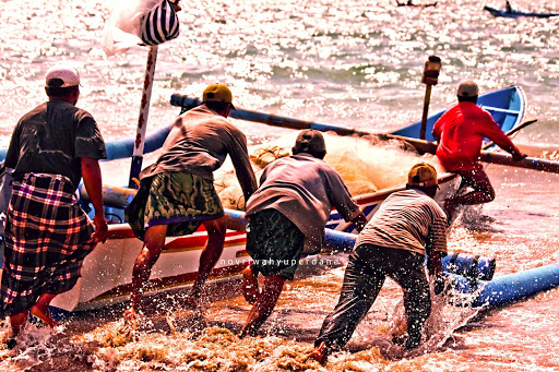 "Bali-fishermen - The photographer: ""The spirit of Mutual Cooperation, or in Indonesia we called it Gotong Royong, is seen in this image. Together these Balinese fisherman helping each other everytime one of them is go fishing by pushing the boat from land to the sea."""