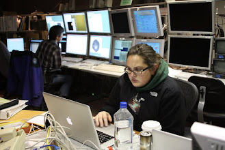 Photo: Gwen is hard at work. Secondly, you'll notice that it takes a GRIP of monitors to get any astronomy done these days.