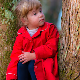 The girl in the red by Tomaž Mikec - Babies & Children Toddlers ( one person, caucasian ethnicity, happiness, forest, fun, leaf, cute, people, child, red, tree, nature, autumn, outdoors, boys, childhood, park - man made space, cheerful, small, smiling )