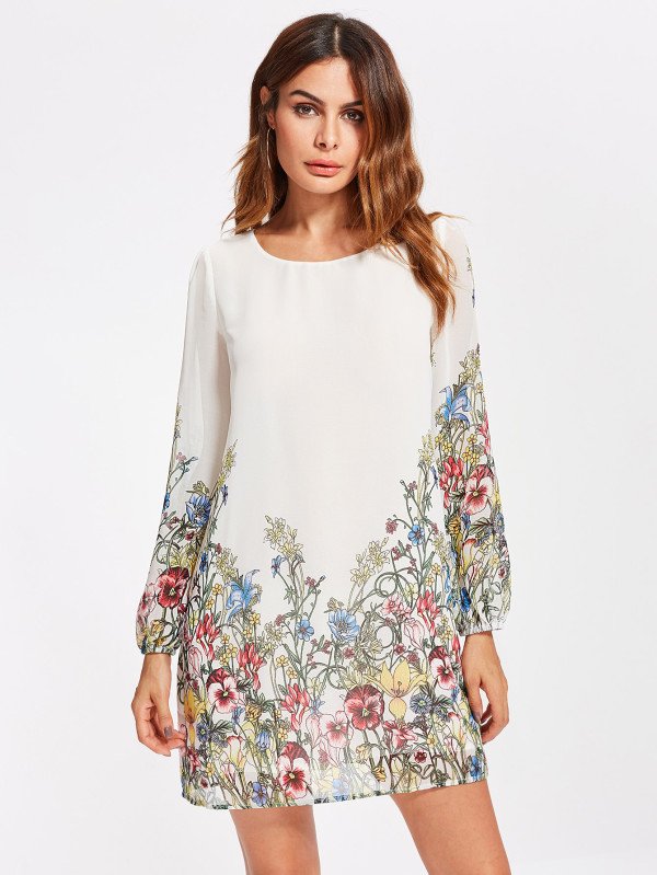Woman wearing a with dress with with flowers on it.