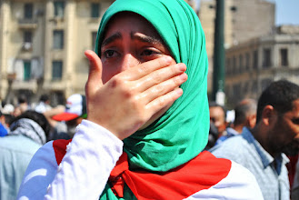 Photo: A woman reacts to the break out of violence during Friday's 'Day of Rage' protest. Clashes between police and protesters broke out shortly after the noon prayer, leading to at least 95 people being killed. Cairo, EGYPT - 16/8/2013. Credit: Ali Mustafa/SIPA Press