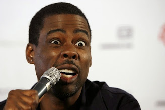 "Photo: US comedian Chris Rock gives a press conference on June 2, 2008 at the Southern Sun offices in Johannesburg ahead of his South African tour starting in Durban. Rock recently earned himself a place in the Guinness Book of world records after drawing the largest comedy audience ever gathered. He broke the record when he performed his ""No Apologies"" show in front of 15,900 fans at London's O2 arena in May 2008.  AFP PHOTO/GIANLUIGI GUERCIA (Photo credit should read GIANLUIGI GUERCIA/AFP/Getty Images)"
