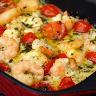 Scampi With Garlic, Feta Cheese And Baked Cherry Tomatoes.