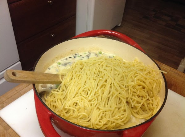 Add drained pasta to the mixture.