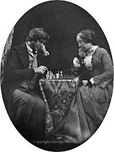 Photo: Wallace playing chess with his sister Fanny in 1853 or 1854. From an ambrotype photograph. Photographer: Unknown. Original in private collection. Copyright of photo: G. W. Beccaloni.