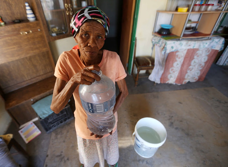 Ann Mouries, 57, of Hillside fills her bottles with water because she fears Beaufort West will soon run out of water. Pictured here 8 November 2017.